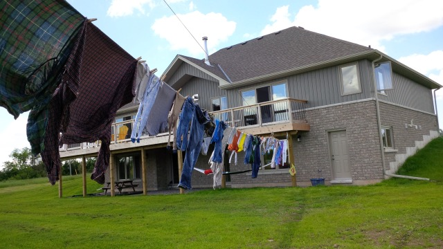Cathy says it really feels like home now that there is a clothes line strung from the back of it.